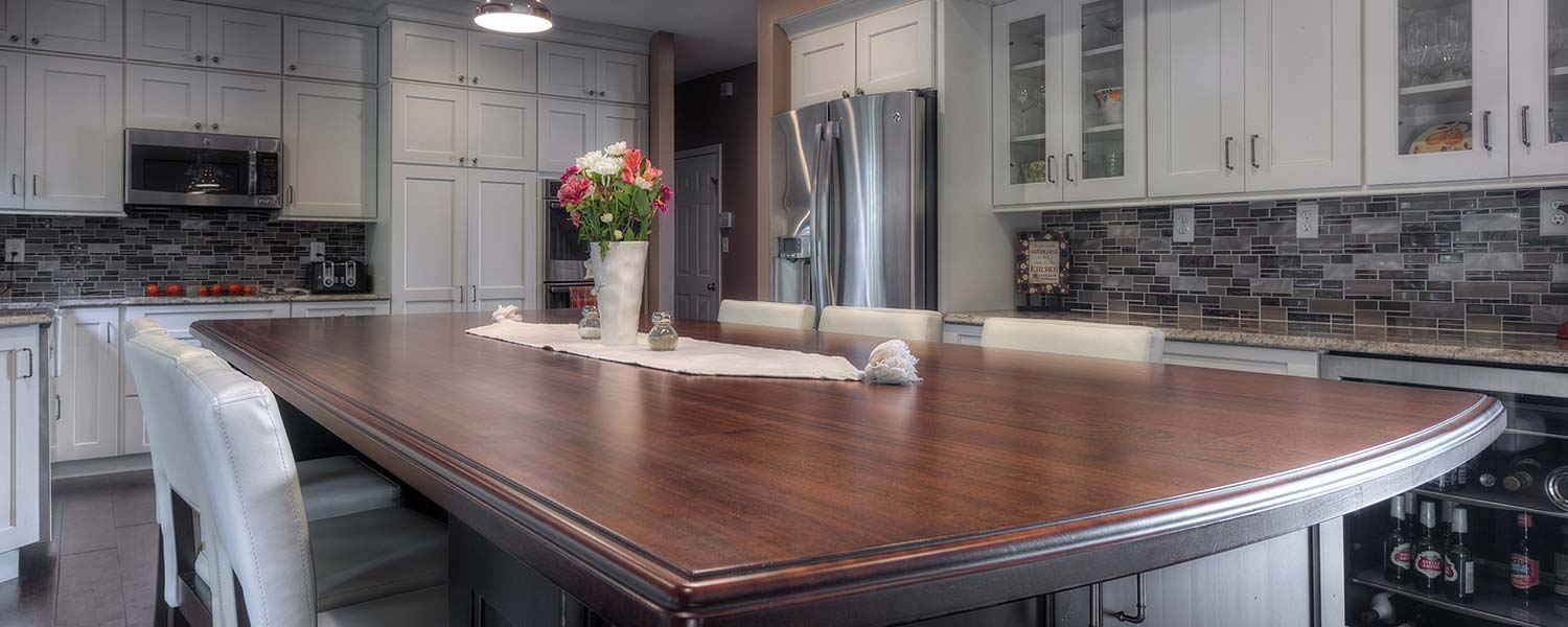 A beautiful wooden countertop that perfectly complements a re-designed kitchen